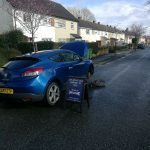 Another image of our mobile mechanic servicing on a blue car
