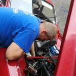 A picture of mobile mike mechanic look at a car
