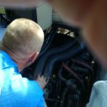 A picture of mobile mike the mechanic servicing an exhaust