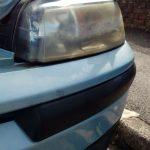 A close up image of a blue head lights