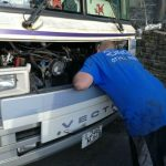 An image of Mike doing some mobile mechanic servicing on a bus
