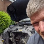 Another picture of mike fixing the car
