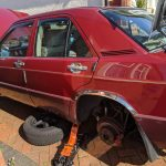 A picture of a red car undergoing our mobile mechanic servicing